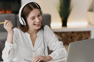 happy-teacher-talking-with-her-students-online